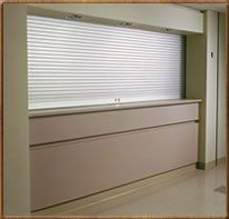 Counter doors are made from interlocking slats of formed steel that will roll up to store in coil above a wall opening providing security Roller Shutters, Window Shutters, Rolling Shutter, Kiosk Design, Shutter Doors, Steel Doors, Interior And Exterior, Counter, Kitchen Ideas