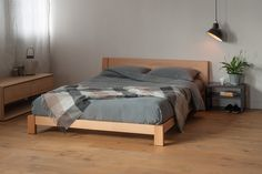 The stylish Java low chunky bed is perfect for lofts. The modern design has a sloping headboard for extra comfort. A solid wood bed Made in Sheffield.