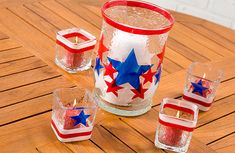 Vellum star stickers would work well. Just buy inexpensive candle holders (think dollar store or Wal-Mart) and reuse every patriotic holiday.