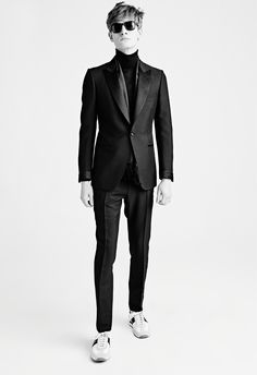 MEN'S AW15 LOOK 26   Black overdyed mélange mohair satin peak lapel buckley cocktail jacket. Black classic cashmere turtle neck. Black overdyed mélange mohair satin trim buckley evening pants with belt loops. Black leo sunglasses. Black silk evening scarf with fringe. White suede textile and leather orford runner with black details.