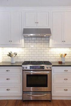 Ceramic subway tile kitchen backsplash white kitchen cabinets with white subway tile beveled subway tile kitchen Kitchen Cabinets Decor, Cabinet Decor, Kitchen Redo, Kitchen Tiles, New Kitchen, Kitchen White, Cabinet Ideas, Country Kitchen, Rustic Cabinets