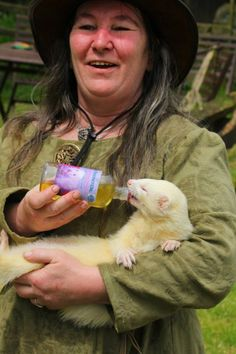 The real 'Maisy Robbins'. Many of Maisy's more outrageous adventures were related to me by my friend Cathy, who runs the Abington Ferret Refuge to which 50% of the royalties have been pledged. And yes, that is Valkerie herself being cuddled and fed.