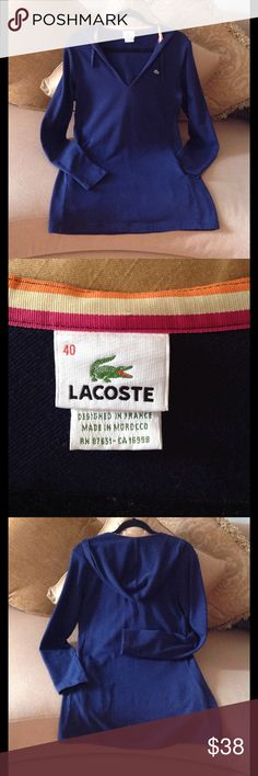🍃🌹 'Lacoste' - Women's Navy Hoodie 🍃 Excellent Condition and very well made Navy Blue Lacoste Pullover Hoodie. Size 40. (Fits Large).  So cute and warm and it's a Fitted style. Not loose or baggy. It has two front pockets and a Drawstring tie. Nice inside striped collar. Perfect for the cooler days for walking or on the beach, watching baseball etc etc. Price is Firm 🍃 Lacoste Tops Sweatshirts & Hoodies