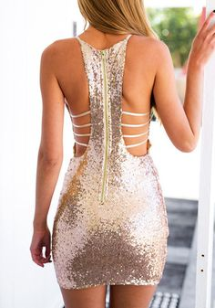 Back view of woman in rose gold sequin cocktail slip dress