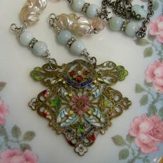 This beautiful necklace began with this stunning vintage 1920's Art Deco cloissone belt buckle in shades of blues and rose with tiny green ivy leaves and just a touch of ivory.  Sooo pretty.  I matche