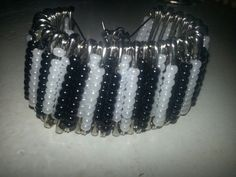Hey, I found this really awesome Etsy listing at https://www.etsy.com/listing/175311279/black-white-safety-pin-bracelet