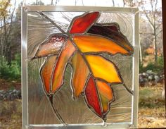 Maple leaf stained glass panel, orange, red, yellow
