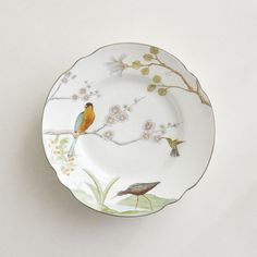 Hand-applied chinoiserie decal and shiny silver rim lend a whimsical touch to fine bone china dinnerware. Modern Dinner Plates, White Dinner Plates, Dinner Plate Sets, Bone China Dinnerware, Ceramic Tableware, China Patterns, Flatware Set, Salad Plates, Chelsea