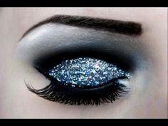 Turquoise glitter eyeshadow with black lining