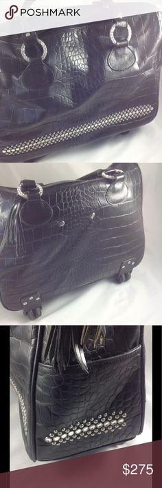 Raviani leather and crystal rolling tote Statement piece for travel, business, or both. Beautiful black embossed leather tote is adorned with crystals and zipper tassels. Outside has crystals and metal studs on front and sides, two side pockets, hidden pull-up handle, and crystals inset on four large circles at straps (one crystal missing, see pic 8, all others intact). Inside lined with logo fabric and sectioned for files, laptop, etc. Will fit in overhead compartment on plane. Raviani Bags…