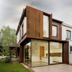 Campanules by EXAR Architecture  Belgian studio EXAR Architecture have replaced walls of brick and plaster with glass and Corten steel on this extension to a suburban house outside Brussels.
