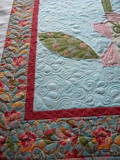Longarm quilting swirls feathers and pebbles