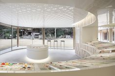 juyosho visitors center at the homangu kamado shrine by wonderwall + jasper morrison Circular Buildings, Mensa, Brick And Mortar, White Texture, Wonderwall, Retail Space, Retail Shop, Display Shelves, Retail Design