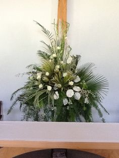 Easter church flowers......This would be a great way to use all the palms left over from Palm Sunday. Very nice!