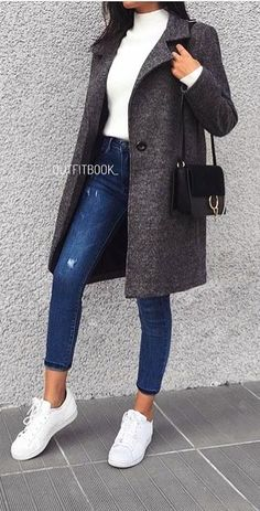 #spring #outfits woman in black coat, white turtleneck top, and blue skinny jeans. Pic by @vogue__cafe