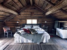 A soft bed, exposed beams, and textured wood all around?! Yes, I want to go to there...