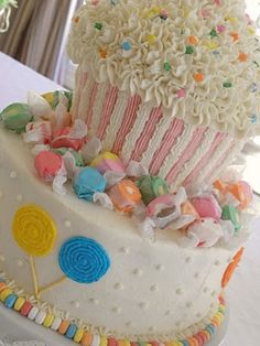 Love this cake with the giant cupcake and salt water taffy