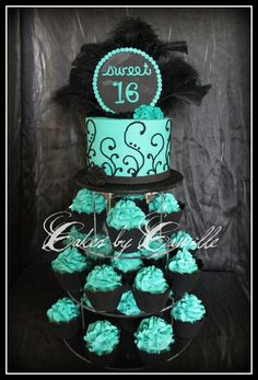 Chic Sweet 16 Cupcake Tower Black and turquoise theme with chic black feathers for that diva touch! Black cupcake wrappers and scroll...