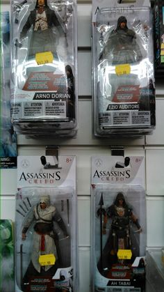 Assassin's creed action figures. Each comes with a download code for additional content, including a new skin for the current game: unity.