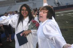 Jessica Alicea, left, and Kasey Reynolds celebrate after the Chambersburg Area Senior High School graduation on Friday, June 8, 2012. (Public Opinion/Ryan Blackwell)