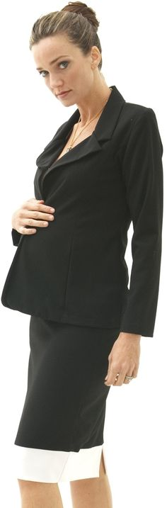 Interviewing while pregnant? A comfortable and stylish one button jacket with an elastic, fitted skirt is a great, professional look. We also like her hair in a bun and subtle necklace.