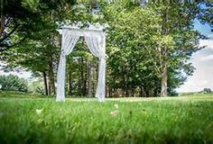 lace curtain wedding arbor