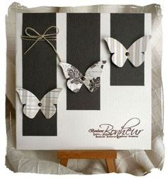 handmade card ... neutral colors ... butterfly punches on graduated length panels ... like the twine bow at the top of the longest panel ... good design ...