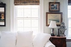Living Room. Love the wall decor, paint color and blind combo.     Decorate | Lonnymag.com