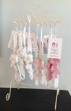 Crochet flower girl headbands on an upcycled jewellery stand - ready for a craft fair