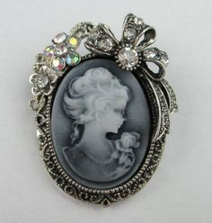 Image from http://i01.i.aliimg.com/wsphoto/v0/571605265/12-pcs-lot-Vintage-Silver-Rhinestone-Floral-Bow-Lady-Portrait-Cameo-Brooch-Pin-BC022.jpg.