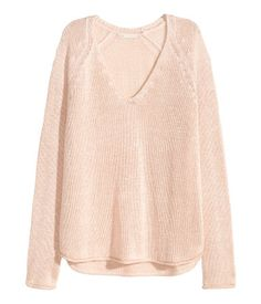 Soft knit sweater with a V-neck, long sleeves, and gently rolled edges.