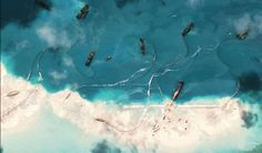 Chinese fishermen intentionally destroying coral reefs for illegal poaching.