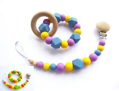 Teething toy / Silicone beads toy / Chew beads toy Set with teething ring and dummy clip! Ring diameter approx: 3,2 inch ( ~ 8 cm ) Dummy clip length 22 cm to 26 cm (included clip). If baby has button style dummy then may need dummy adapter which you can add to cart here: