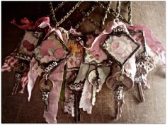 ALTERED ART - cool necklaces that could use keys, crosses, hearts, ribbon, lace and the little metal frames from Factory Direct!
