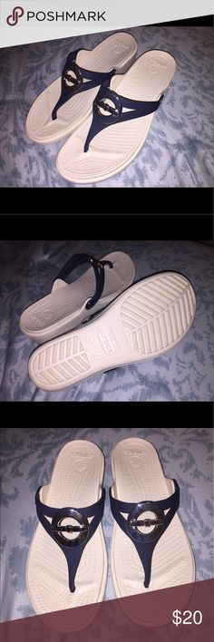 Crocs Sandals NWOT Selling a pair of dark blue and cream colored Crocs Sanrah Women's Wedge Sandals in perfect condition super comfortable and beautiful! CROCS Shoes Sandals