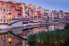 Best Cities to Visit in Spain Girona has been a focal point of the northern part of Catalonia since being part of the Roman Empire. Its wealth in medieval times produced many fine Romanesque and Gothic buildings that have survived repeated attacks and sieges. The old town is on the east bank of the river that runs through the city, with pedestrianized narrow streets surrounded by the old city walls. Girona also offers a lively nightlife, a great eating scene and art and music festivals.