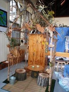 An autumn house! I wooden frame wrapped with string and decorated with tree stump seats and tables and leaves.