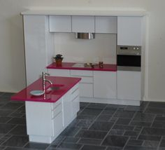 New VARI kitchen in 1:16    Perfect for the Brinca Dada Emerson house, and featuring innovative interchangeable worktops, shown here in white with pink glass tops.  Features column oven, sensor hob, doors/drawers, and a minimalist extractor fan, along with an underslung sink in the island, which also has a breakfast bar extesion.