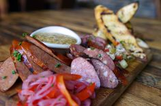 """""""Local farm-to-table sausages the perfect plate to share. #uptown #sustainableagriculture #organic #foodie #healthy #localfoodforlife #growyourownfood #healthyeating #farmtofork #organic_farming #groworganic #cleaneating #freshfood #growyourown #farmtotable #eatlocal #knowyourfarmer #health #local #localfood #organicfood #supportlocalbusiness #healthychoices #urbanagriculture #sustainable #healthyliving"""" @frenchmeadowcafe"""