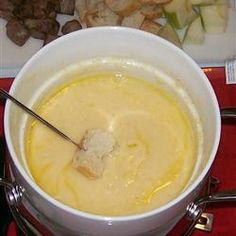 Cheese Fondue Recipe - this stuff is seriously delicious, y'all! Try it with sourdough bread, apples, and veggies. Add lemon juice if the cheese gets clumpy and rub a garlic clove on the inside of the pot before pouring in the cheese. YUM! I love this stuff :)