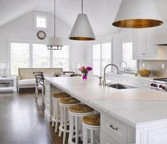 I love the pendant painted brass inside over the kitchen island and beautiful off the breakfast table is so inviting