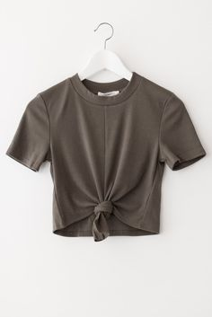 Mock neck crop top with front knot detail and short sleeves. Made with soft and…