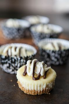 Mini never tasted as good as these White Russian Mini Cheesecakes! Fun for everyone to snack on. #dessert #recipe #cheesecakes
