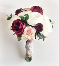 Marsala is a beautiful colour for Autumn weddings. Made with silk roses in Ivory and Marsala/burgundy and greenery, finished with a burlap and lace wrap. This bouquet has a wild flower feel, they look so real, they are made with the highest quality silk flowers.  Measures 12  diameter approx.   *** If you have any special requests or requirements please do not hesitate to contact me using the Contact Shop Owner button, I will try my upmost to meet your needs***  This design can also be m...