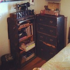 A steamer trunk opened with a small bookshelves set inside it. Proud to say this was my ORIGINAL idea and pin! :)