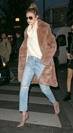 Gigi Hadid in ripped boyfriend jeans, a cowl-neck cream sweater, cage heels and a brown Katie Ermilio fur coat - click through for more celebrity-inspired winter outfits!
