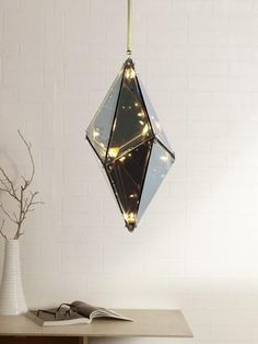 Hedron Luxury Pendant Lamp | Buy Fancy Hanging Lights Online India - The Hedron is a magical hanging light which has a charming effect as it plays with light and reflection when it is turned on. When turned off, the glass surface of the pendant light has a mercurial effect, however when it is turned on, the glass surface becomes translucent, and the lights glow in the form of a constellation Room Lights, Hanging Lights, Wall Lights, Ceiling Lights, Luxury Lighting, Lighting Store, Outdoor Lighting, Decoration Lights For Home, Light Decorations
