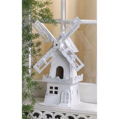 Windmill Bird House. This classic windmill bird house will make any little birdie feel free as the wind. Gingerbread trim on whitewashed wood create a lovely Dutch bird house.