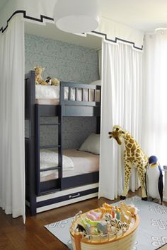 source: Hillary Littlejohn Scurtis Chic, sophisticated neutral gender kid's room with black bunk beds framed with white valance with black trim & white curtains, pink bedding, blue damask wallpaper, blue medallion rug and FAO Schwarz Melissa & Doug Plus Home Bedroom, Girls Bedroom, Bedroom Ideas, Bedroom Nook, Bedroom Decor, Decor Room, Bunk Rooms, Bunk Bed Designs, Kids Bunk Beds