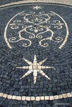 Swirls and stars, black and white cobbled paving in Velas, São Jorge island, Azores